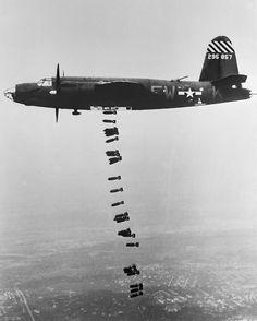 "Martin B-26B Marauder ""Shootin' In"" of the 556th Bomb Squadron releasing its bomb load, 1944-45."