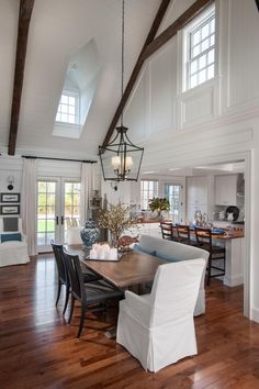 This #DiningRoom is beautiful, bright and open with warm touches in the hardwoods and wooden beams.