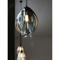 Designed and Handmade by Oliver Höglund. Molten hot glass shaped and hand-blown at one thousand degrees celsius. An organic warped teardrop shape made with quality Swedish clear glass to dress a traditional filament bulb. The long filaments shine and refract off the contours of the VØLT pendant to give a unique one of a kind lighting design. Handmade with love and passion in New Zealand.