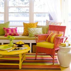 The colorful cottage decor makes this seating area an energetic and exciting space to entertain! See more rooms to love at the distinctive cottage. Dark Wood Furniture, Painted Furniture, Outdoor Furniture Sets, Painted Wicker, Painted Wood, My Living Room, Living Room Decor, Small Living, Living Spaces