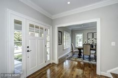 March Wind. Sherwin Williams. Traditional Entryway with 3-1/8 in. x 3-1/2 in. x 94-1/2 in. Dentil Polyurethane Crown Moulding, Hardwood floors