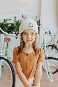 The cutest, happiest hat! We have it in gray and beige and it's THE BEST. It fits ages 1-5 on average and is so soft and comfy!
