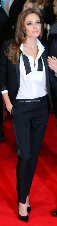 Angelina Jolie: Jacket, shoes, and pants – Saint Laurent  Jewelry – Tiffany & Co.