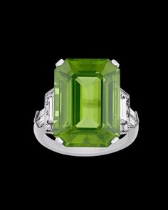 Raymond Yard Peridot Ring, 17.27 Carats~ A lush 17.27-carat emerald-cut peridot showcases its unmistakable green hue in this Raymond Yard ring. This brilliant jewel is encircled by a myriad of trapeze, half-trapeze and round-cut white diamonds totaling 1.17 carats in its platinum mounting. ~M.S. Rau Rare Gemstones, Alexandrite, White Diamonds, Emerald Cut, Peridot, Snow Globes, Hue, Garnet, Yard