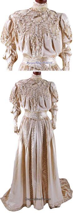 Wedding dress ca. early 1900s. One piece, ivory silk satin with mechanical lace and lace appliqués. Train. Museo del Costume e della Moda Siciliana via Cultura Italia