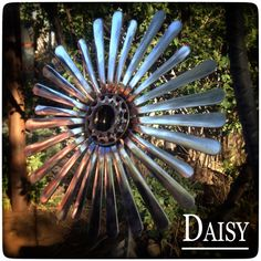 The Daisy is a simple but pretty design made with flatware, serving cup and some bike parts i have lying around. They are TIG welded which adds some color