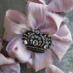 """Corsage with Crown Brooch  Hand dyed silk dupioni is crafted into a lovely medallion with a vintage inspired crown brooch in the center. Great favor for a party or tie on for a gift.        Measures 4""""W x 4""""L      Made in the USA"""
