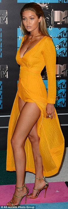 Gigi Hadid glows in bright yellow gown with plunging neckline at VMAs #dailymail