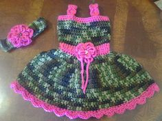 This item is a girly camo and hot pink baby or toddler dress with matching headband. It is crocheted with camoflage yarn, and has a pink