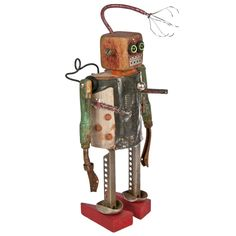 "Monk #855.  This folk art robot was crafted by artist Kent Greenbaum using recycled toys and industrial parts. Robot is named, numbered, and signed on the back. H 12.5"" W 5.5"" D 4""."