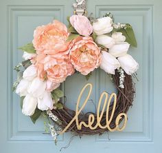 This beautiful blush and gold wreath is a MUST HAVE for the upcoming spring season! (Or ANY season!) Featuring white tulips and blush pink peonies, it will look perfect hanging on your front door or displayed inside on a mantle or shelf! Welcome guests with a cute little message that compliments the wreath perfectly! DETAILS - 12 grapevine wreath - Spring/southern themed flower stems - Wooden hello word *Please note: Due to availability, some flowers/colors may vary from the pho...
