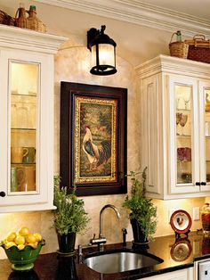 love the art work in the kitchen - adds a whole different feel . . .