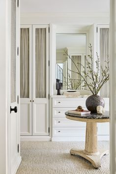 Nate Berkus and Jeremiah Brent Transform an NYC Town House Into a Family Home. The master dressing room features custom cabinetry by Hetman. Vase by Casey Zablocki atop a French table. Nate Berkus, Architectural Digest, Jeremiah Brent, Home Living, Living Room Sofa, Living Rooms, Slow Living, Modern Living, Living Spaces