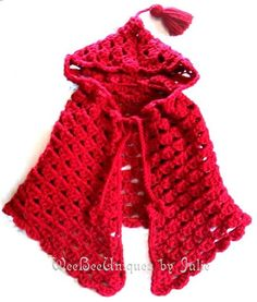 Red crocheted hooded cape. Mum had one of these made by her mother when she was a baby. It was green and IDENTICAL to this one. Betty + I used to dress our dolls in it. I REALLY want this!