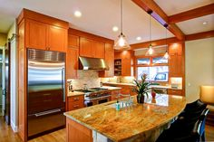 HGTV invites you to see this contemporary eat-in kitchen with warm wood cabinets, granite countertops and stainless steel appliances. Small Galley Kitchens, Galley Kitchen Remodel, Dream Kitchens, Kitchen Pendant Lighting, Kitchen Pendants, Pendant Lights, Pass Through Kitchen, Cherry Cabinets, Eat In Kitchen