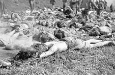 A dead Chinese soldier, his burned uniform still smoking, lies with bodies of his comrades at a collection point near Chunchon on May 17, 1951 after allied forces had stemmed the major enemy attack near the town on Korea's central front. (AP Photo/ENJ)