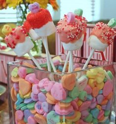 I made these last V-day, but they are even cuter with the candy heart standing up on top!