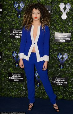 Hard to miss: The curly-haired singer commanded attention in her choice of attire, which saw her sport a vivid blue trouser suit - and not much else