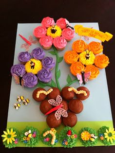 Flower pot and garden bug cupcake cake