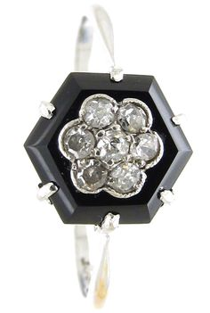 Art Deco Hexagonal Onyx & Diamond Ring  Art Deco (1920-1935)Item No. 922E A simple Art Deco onyx and diamond ring of hexagonal design set to the centre with a flower shaed diamond cluster.