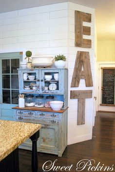 EAT sign created out of reclaimed lumber by Sweet Pickins Furniture... I'm thinking my handy man could do this.. maybe monogram though!