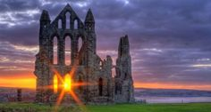 Sunset through a window of the ruins of Whitby Abbey in North Yorkshire, England. Oh The Places You'll Go, Places To Travel, Places To Visit, Beautiful World, Beautiful Places, Beautiful Ruins, Beautiful Buildings, Whitby Abbey, Literary Travel