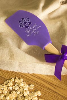 The reason Mom's cooking always tasted extra-special was her secret ingredient -- love! Get something cooking up in your kitchen and share the love with our paw print-accented silicone spatula that includes measurement conversion chart on the back.