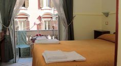 Hotel Sol Levante Roma Just a 3-minute walk from Roma Termini Station, Hotel Sol Levante offers classic accommodation in the centre of Rome. The property is 400 metres from Castro Pretorio Metro Station that takes you to the Colosseum.  Rooms here feature a TV.