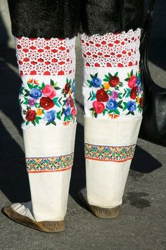 """""""Traditional Inuit Boots with Floral Embroidery Inuit woman wearing traditional Greenlandic national costume or Kalaallisuut in Ilulissat on Greenland. The costume consists of seal skin boots (Unnaat) bead necklaces (Nuilaqutit) and seal skin trousers (Takisut)."""""""