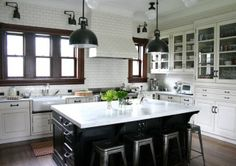 white subway tile with dark grey grout (wall to ceiling), butcher block island, carrerrar marbel islamd