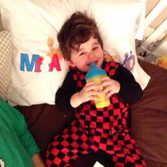 J.R. loved his new #SesameStreet pillow!! http://instagram.com/p/xDQIOUIaoZ/ He loved it too much! So much that he started crying when I told him it wasn't safe for him to go to sleep with it because he's not big enough yet. He got super emotional over #Elmo! Kept repeating his name! Awwwww! #JRhilton #Christmas #Navidad #FelizNavidad #MerryChristmas Sesame Street