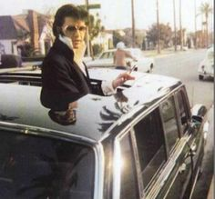 Elvis sticks his head out the top of his 1960 Mercedes Benz 'Pullman'