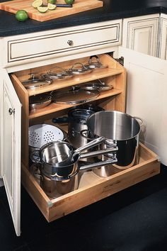 Pullout drawer with integrated shelves allows you to store large pots and their corresponding lids easily.