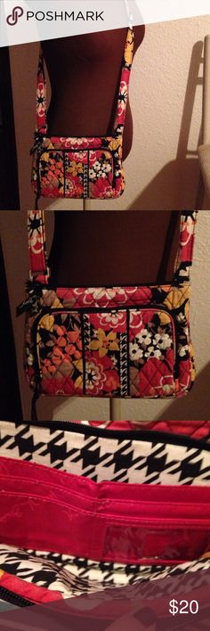 Vera Bradley purse Fall colors of orange, golds, rusts, white forming flowers and leaves all over.  Inside lining is like a large black and white houndstooth.  Front pocket has places for money, IDs, credit cards and carrying space.  The inside has a side zipper.  Nice long adjustable strap. Vera Bradley Bags Crossbody Bags