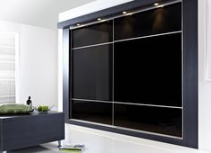 Furniture. large black glass bedroom cabinet with sliding door connected by white wall theme. Modern Design Of Bedroom Wall Cabinet With Mirror To Complete Your Bedroom