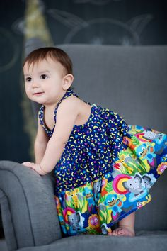 French Bull's Kids Jungle Collection for Windham Fabrics. So many cute prints, sew many possibilities - like this adorable baby dress!