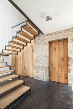House JA by Filipe Pina & Inês Costa (10) Great stairs and rustic oak