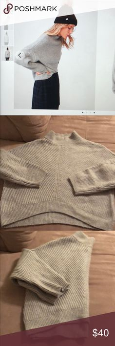 Express funnel neck gray sweater size M Express funnel neck gray sweater size M. Very cozy sweater great details. Express Sweaters Cowl & Turtlenecks