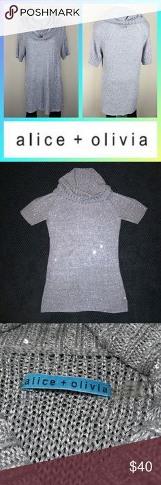 Alice and Olivia cowl neck grey sweater sequins Alice + Olivia Women Sweater Medium Sequin Cowl Neck Tunic Gray  Size: M  Length (inches): 30  Underarm to underarm (inches): 17  Color: Gray  Pattern: Solid  Pre-owned sweater. Small catches in the knit fabric. Unnoticeable unless you're searching for them. Good condition!!! Alice & Olivia Tops