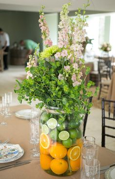 Citrus floral arrangement designed by Heaven & Earth Floral. See more of this elegant destination wedding. http://www.weddingchicks.com/gallery/classy-destination-wedding/?pid=142169