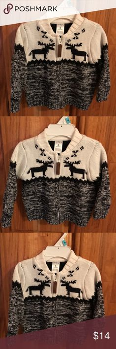 Carter's reindeer sweater Beautiful white zip up sweater with a black and white marble half bottom, featuring reindeers on front. 6M like new condition worn once! Carter's Shirts & Tops Sweaters
