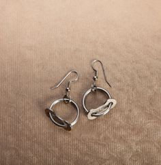 Balanced Earrings by Simply Spoken available at Terry.  The balance earrings are brilliantly recycled using a single link of chain threaded with a piece of stainless steel spoke. #bikes #jewelry #cycling