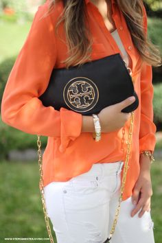 tory burch clutch/Crossbody.... Please show up at my doorstep anytime.