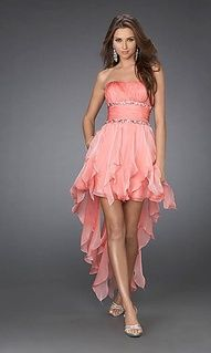 A pink/orange ruffle strapless hilo with a belt with sparkles on the top and bottom of the belt! so hot!