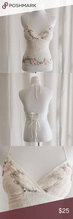 Vintage Halter Bra This vintage halter bra features padded cups and a tie back. Size is adjustable but would best fit a SMALL. Beautiful beading covers the front. Can someone please wear this to a music festival it's too perfect. ❤️feel free to make an offer❤️ Vintage Tops Camisoles