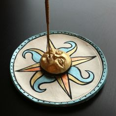 Check out my new Etsy page! Hand painted incense holder with sun/compass design… Fimo Clay, Polymer Clay Projects, Clay Crafts, Ceramic Pottery, Ceramic Art, Compass Design, Incense Holder, Incense Sticks, Incense Burner