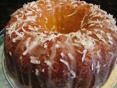 Pineapple Coconut Rum Cake unsalted softened butter and crushed pineapple in natural juice (drain as much juice as possible). Drizzle with a cream cheese and rum glaze and top with more coconut. Köstliche Desserts, Delicious Desserts, Dessert Recipes, Yummy Food, Plated Desserts, Easter Desserts, Easter Cake, Food Cakes, Cupcake Cakes
