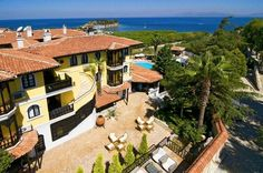 Commercial property: sea view boutique hotel for sale in Kusadasi, Turkey. 60 meters from the Aegean Sea. Turkey Hotels, Commercial Real Estate, Black Sea, Swimming Pools, Tours, Mansions, House Styles, Beach, Places