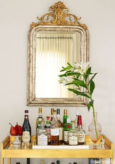 A gilded mirror and cart add the appropriate amount of glitz to a six o'clock cocktail.Click through for more home bar design ideas.
