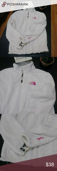 SALE The North Face breast cancer awareness fleece Be ready October 1st with this North Face breast cancer awareness fleece. Size medium cozy white fluffy zip-up fleece jacket with no stains rips or holes. In great preowned condition The North Face Jackets & Coats